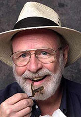 Photo of Jerry snacking on cooked frogs.